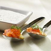 Party snacks: salmon with salmon caviare on spoons