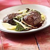 Whole kidneys on vegetables
