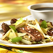 Pieces of duck breast with Asian vegetables
