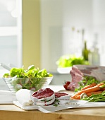 Kitchen scene: preparing meat, salad and vegetables
