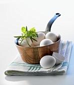 White eggs in a copper pan