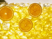Orange juice with ice cubes and slices of orange