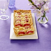 Plum cake with marzipan, a piece cut