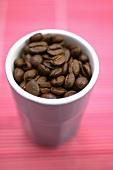 Coffee beans in beaker