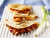 Tortilla triangles filled with salsa