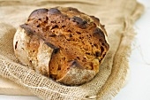 Farmhouse bread with bacon and onions on jute