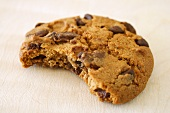 Chocolate chip cookie with a bite taken