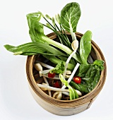 Asian vegetables in steaming basket