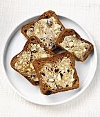 Buttered malt loaf on plate