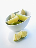 Pieces of lime in and in front of a bowl