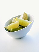 Lime wedges in a bowl