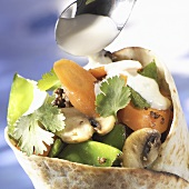Vegetable wrap with yoghurt sauce