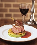 Duck leg on pea puree and potato rosti