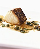 Fried cod with caper sauce