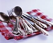 Silver cutlery on cloth