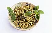 A plate of spaghetti with basil pesto