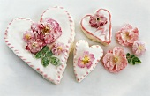 Three heart-shaped cakes with sugared roses