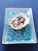 Opened oyster on ice
