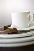 Coffee cup with saucer and chocolate