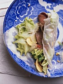Beef with lettuce and star fruit on rice paper