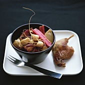 Duck with root vegetables and red chard stalks