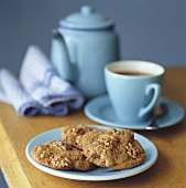 Walnut biscuits, a cup of tea and teapot