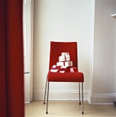 Wrapped gifts on red chair