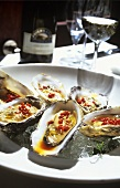Oysters with chili and olive oil on ice