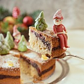 Carrot cake with marzipan figures for Christmas