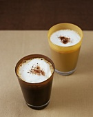 Coffee with milk froth and cocoa powder