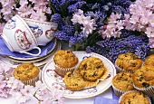 Raisin muffins on table with grape hyacinths and blossom