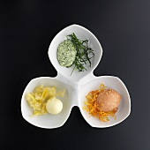 Various types of butter on deep-fried vegetables