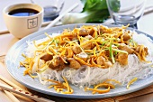 Chicken with orange zest and glass noodles