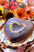 Chocolate heart with daisies