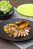Grilled beef steak with pineapple and potatoes