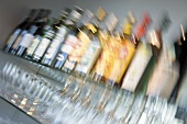 Bar rack with bottles and glasses