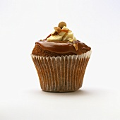 Chocolate banana muffin with caramel frosting and hazelnut