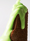 A piece of chocolate cake with mint sauce
