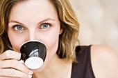 Woman drinking an espresso