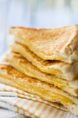 A pile of toasted cheese sandwiches