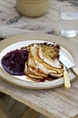 Roast pork with red cabbage and potato rosti