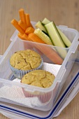 Corn muffins and vegetables for packed lunch
