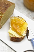Yeast cake with orange, almond and apricot jam