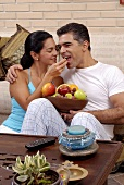 Young couple with a bowl of fruit