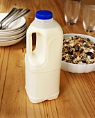 Milk in plastic bottle and wholefood muesli