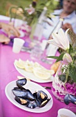 Mussels on table at a garden party