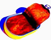An opened sardine tin