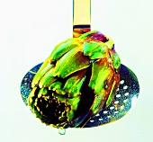 An artichoke on a skimmer