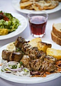 Lamb kebabs with potatoes and salad