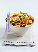 Fried egg noodles with vegetables and turkey